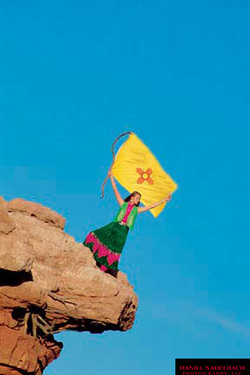 Woman on Cliff with Flag | Santa Fe Chamber of Commerce | Santa Fe, NM